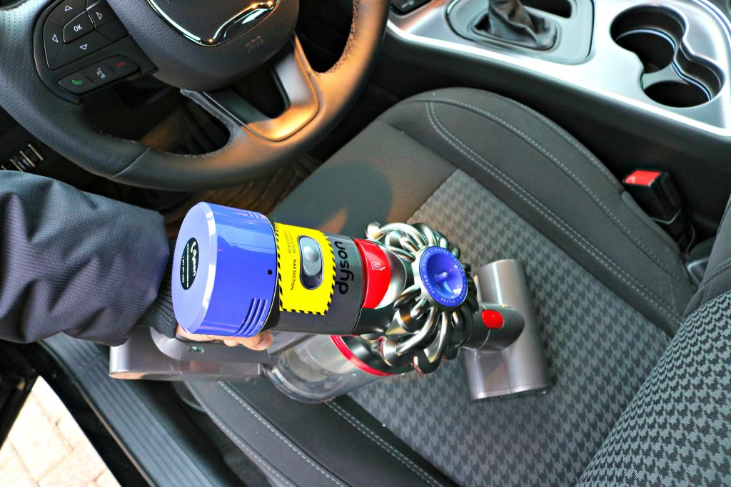 Hand attachment on the Dyson V8 Absolute. Darasak vacuums his car.