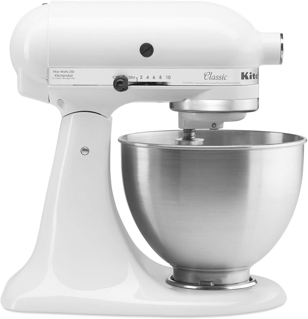 A white Kitchen Aid Stand Mixer with bowl.