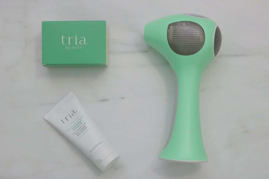 Tria hair removal tool and Tria gel flay lay.