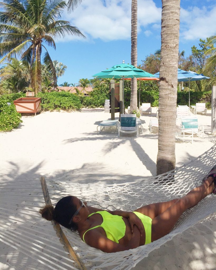 Gabby laying in a hammock in the Bahamas.