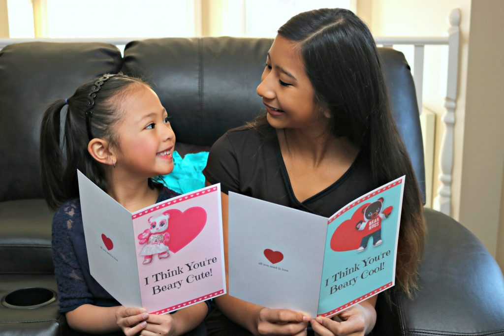 Celebrate Valentine's Day with Build-A-Bear + FREE Beary Cute Valentine's Day Card PRINTABLE! Two little girls exchange Valentine's Day cards.