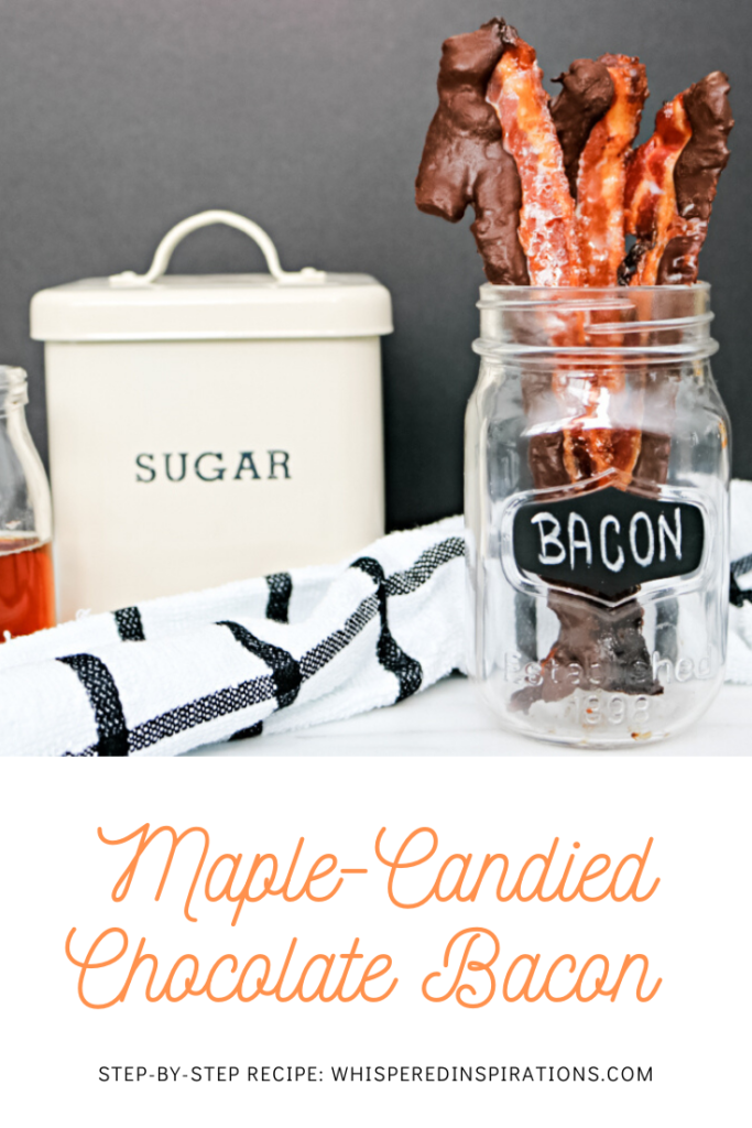 "A mason jar holds chocolate-covered bacon and sugar and maple syrup and a striped napkin are shown. A banner reads, ""Maple Candied Chocolate Bacon."""