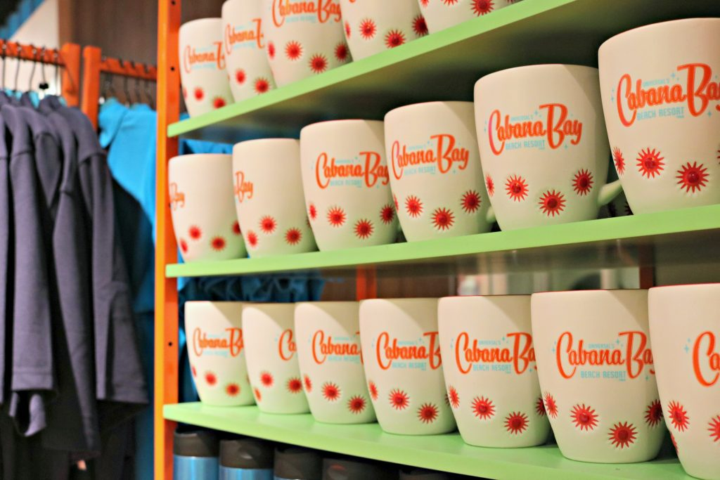 3 rows of Cabana Bay Beach Resort mugs inside the gift shop at the Cabana Bay Beach Resort.
