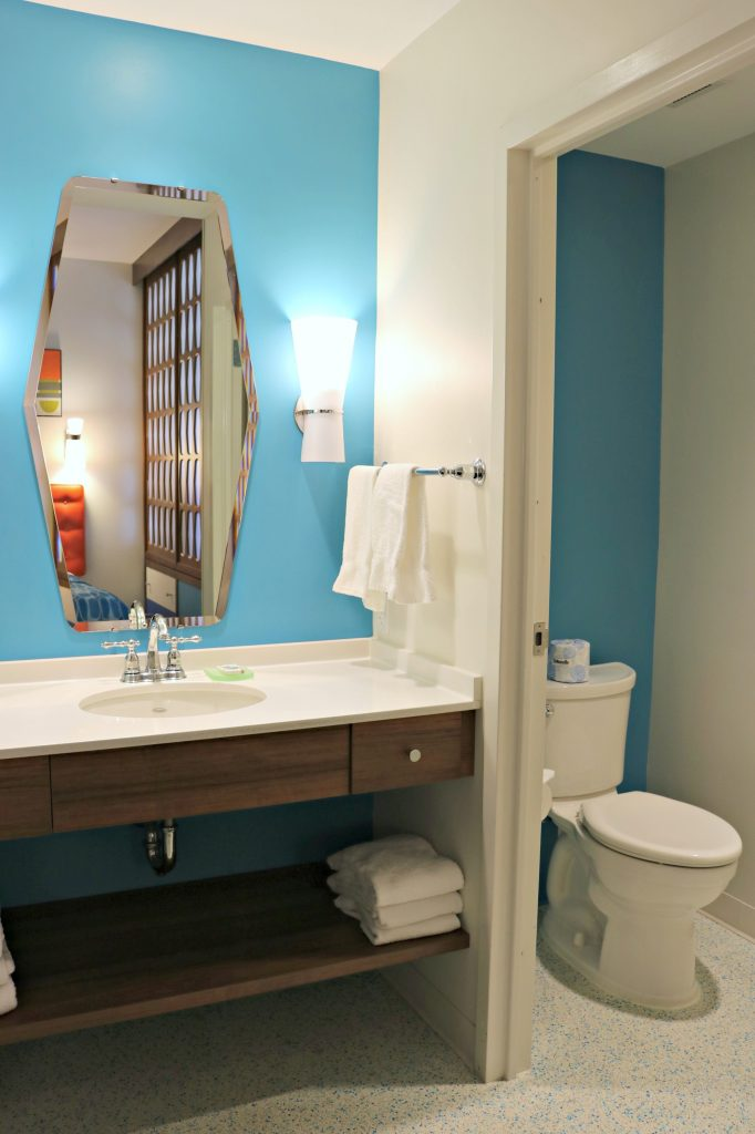 The other side has the toilet that is separate to the vanity at the family suite at Cabana Bay Beach Resort.