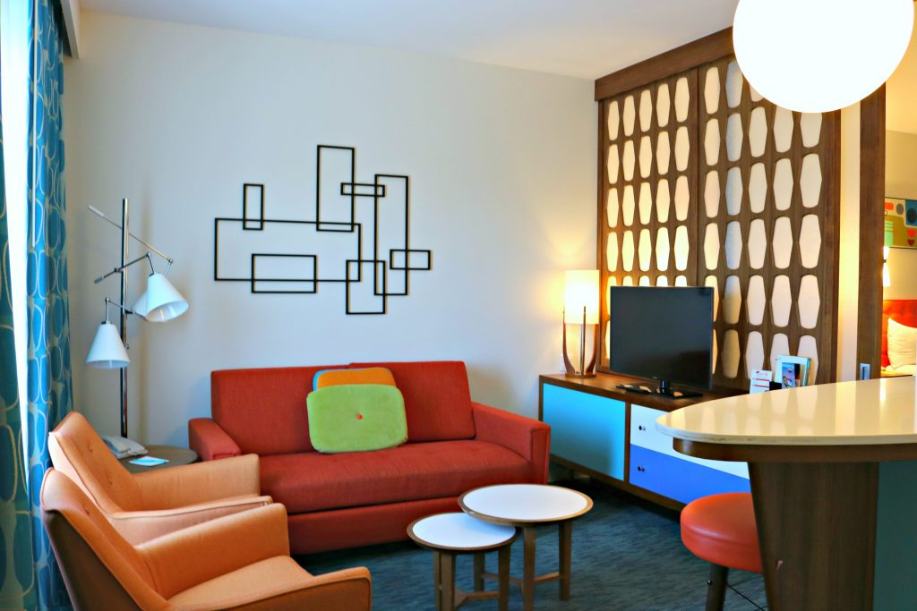 The living room area with a pull out couch in the family suite at Cabana Bay Beach Resort.
