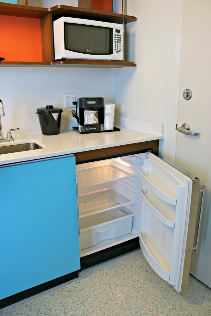 The kitchenette with a microwave, mini fridge, and coffee maker.