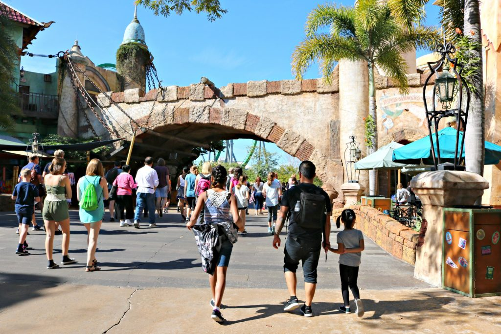 A dad and his two girls walk into Island of Adventure.