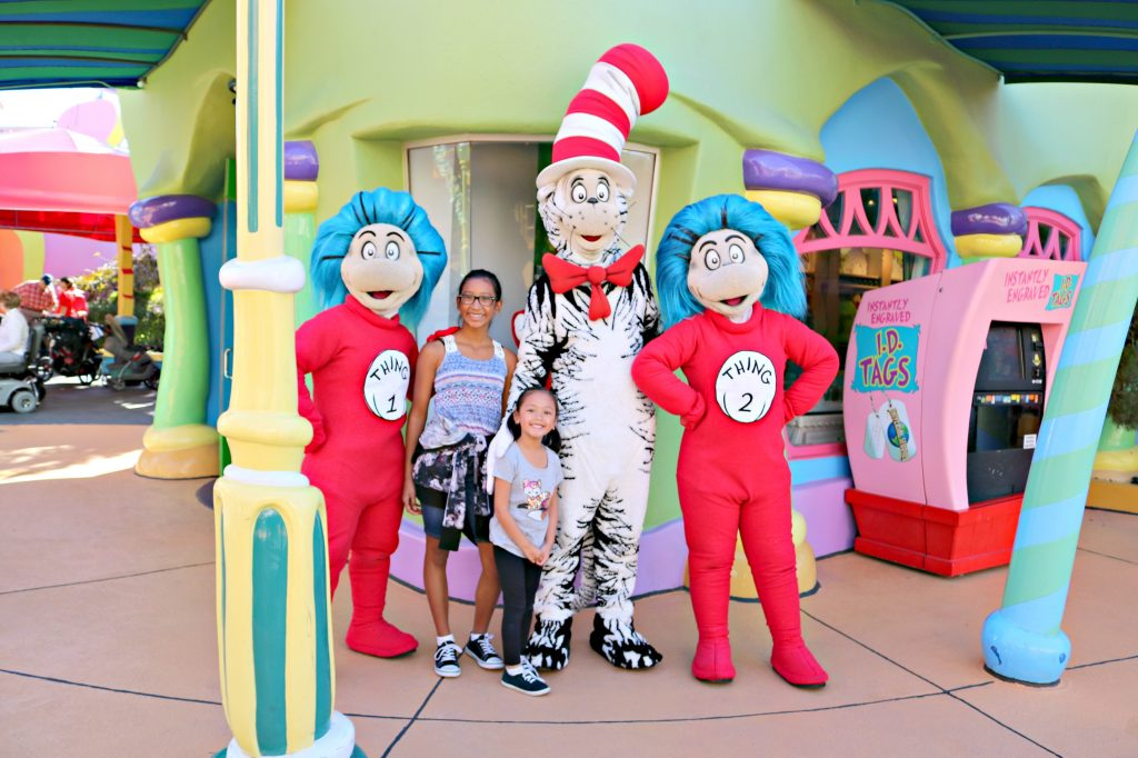 Two young girls stand with the Cat in the Hat and Thing 1 and Thing 2.