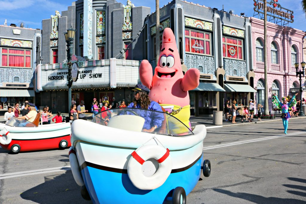 Patrick smiles happily on his boat float.