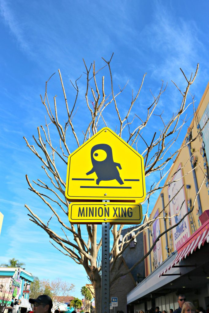 A yellow sign that reads Minion X-ing.