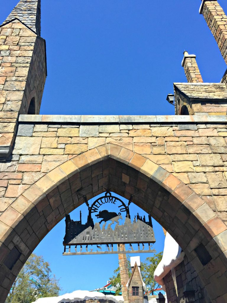 The sign of Hogsmeade at its entrance.