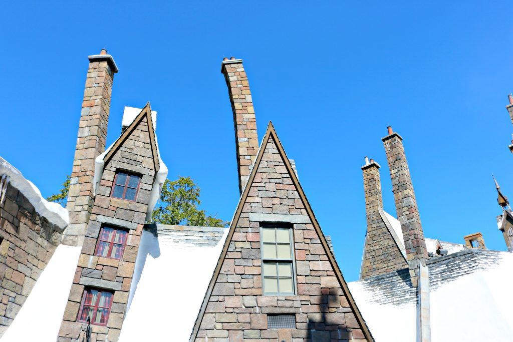Hogsmeade's twisting buildings topped with snow.