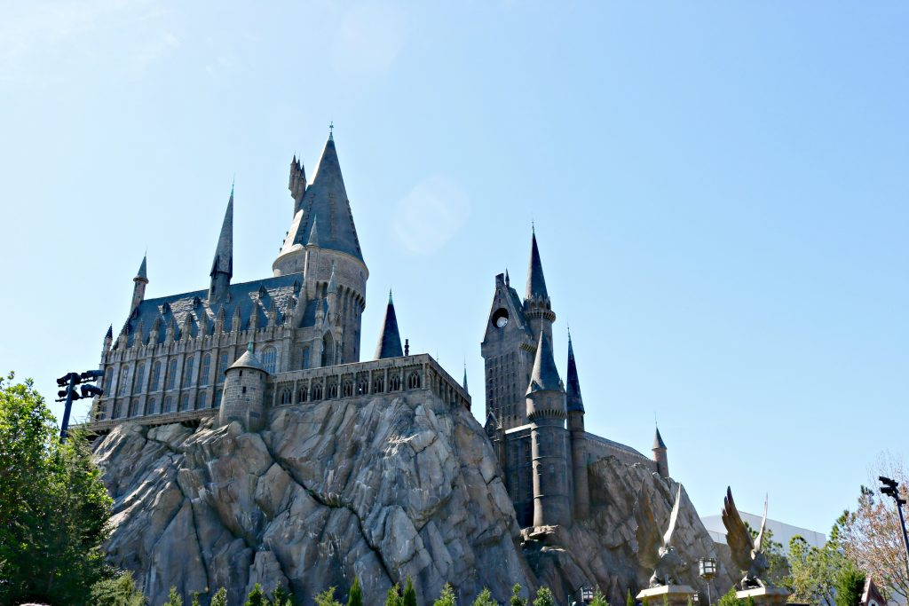 Hogwarts Castle is shown against a beautiful blue sky.