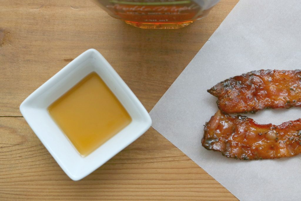 A top view of maple syrup and maple-syrup glazed bacon