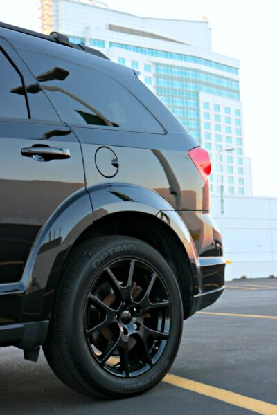 The back end of a Dodge Journey is shown in a parking lot.