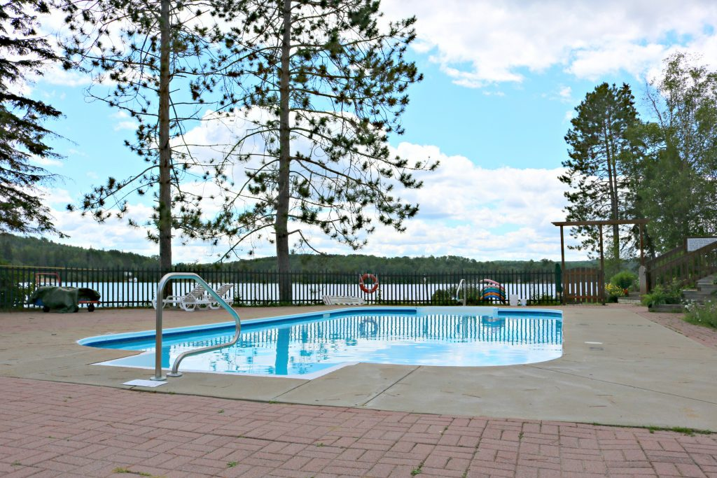 The outside pool at the Couples Resort is surrounded by the lake.