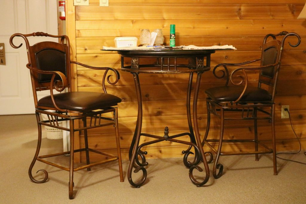 A bistro set for two is shown inside the room.