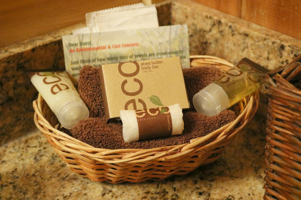ECO toiletries, face towels, are in a basket.