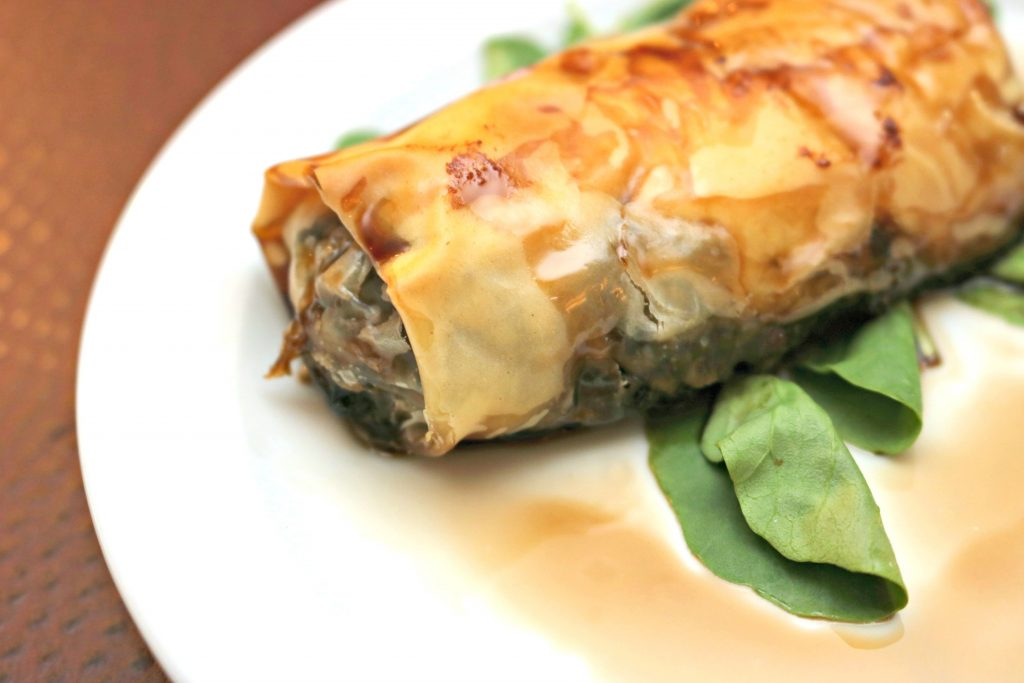 A phyllo wrapped appetizer stuffed with delicious quinoa.