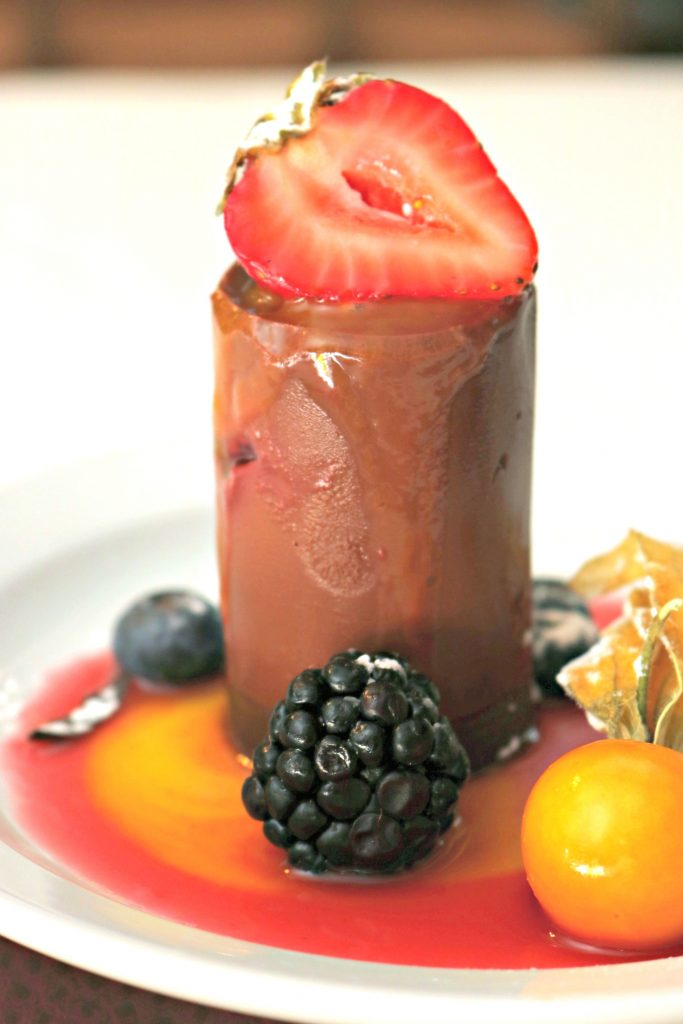 A delicious chocolate mousse with berry compote.