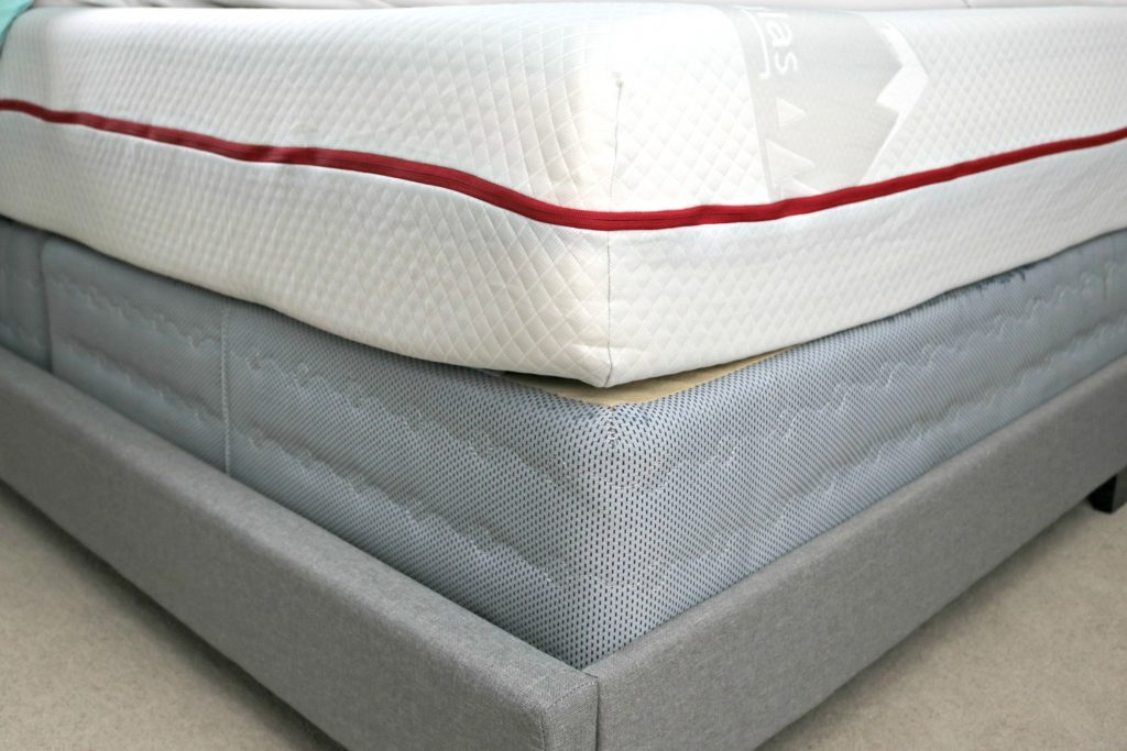 A lower view of the Douglas Mattress from GoodMorning.com. The mattress, box spring, and frame are pictured.