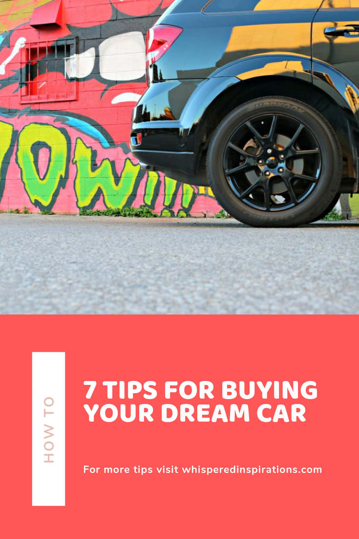 "A Dodge Journey is pictured in front of a graffiti wall, a banner below reads, ""How To: 7 Tips for Buying Your Dream Car."""