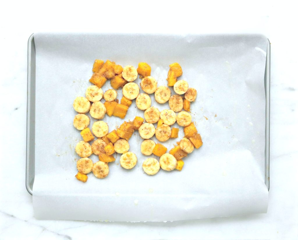 Cookie liner with wax paper lining shows bananas and mangoes being roasted.