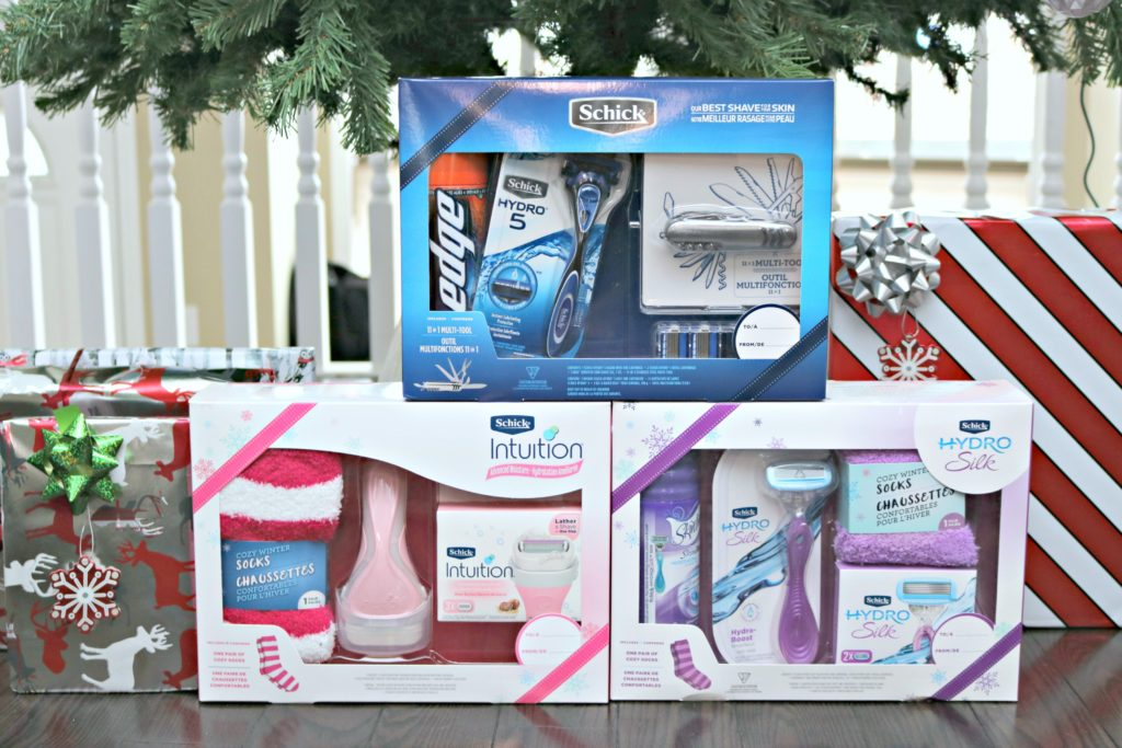 3 Schick Holiday Gift Sets are placed under the tree with other gifts.