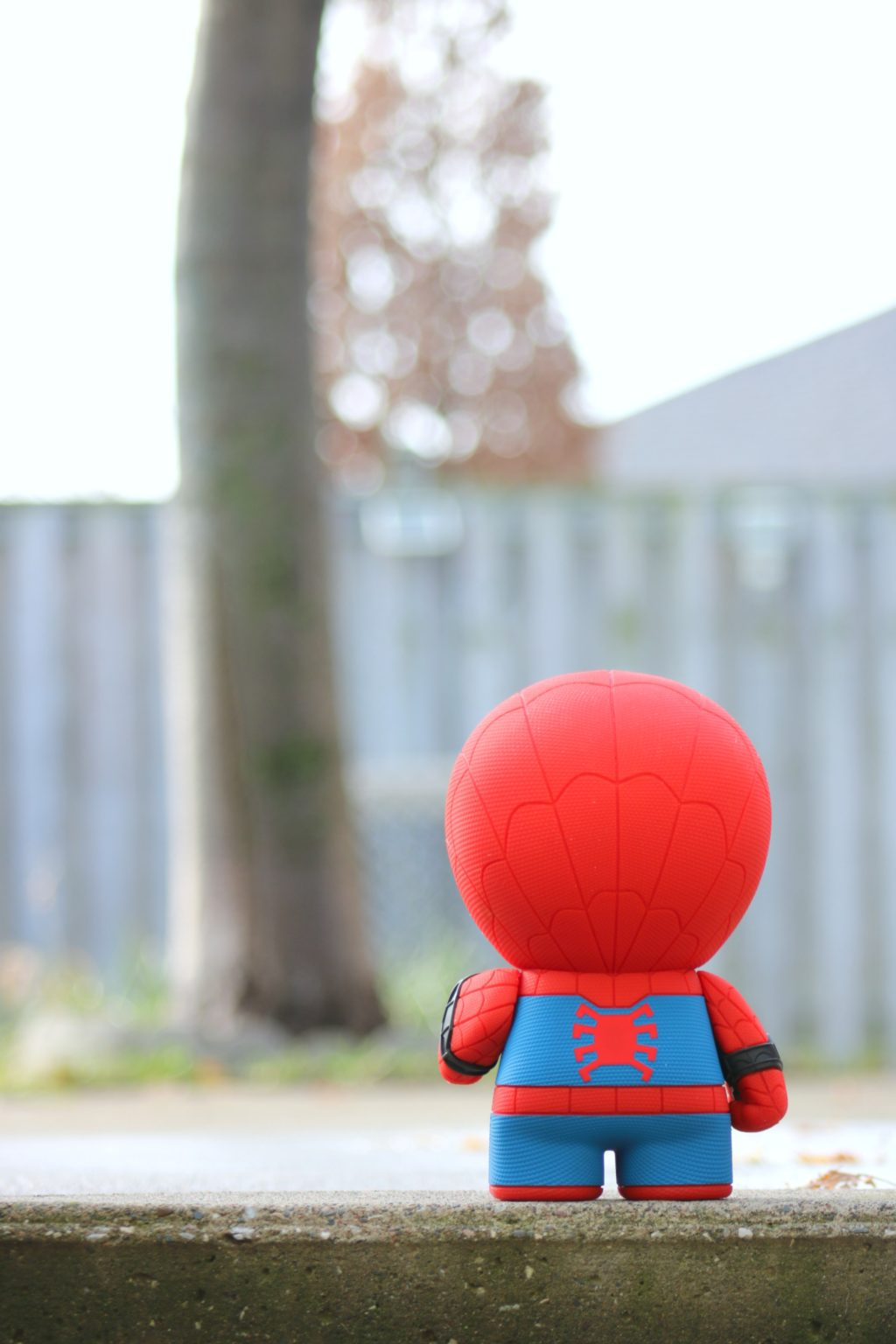 One of the Must-Have Gifts for Spider-Man and Marvel Fans! LIttle Spiderman stands outside in what seems like a big world, a tree is in front of him.
