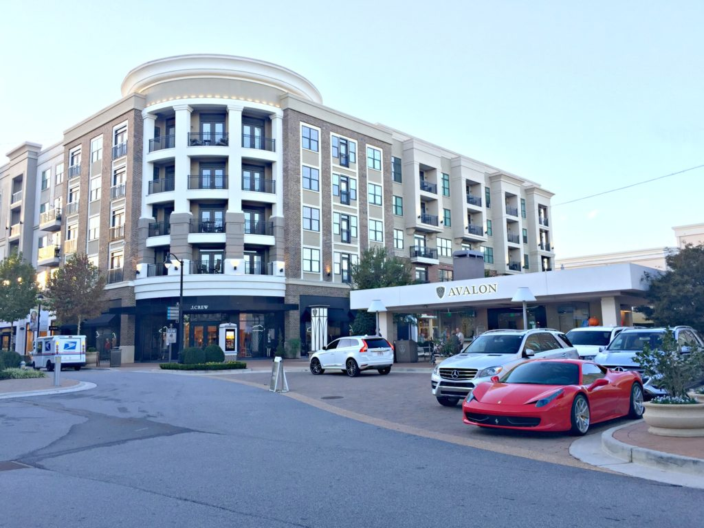 The Avalon shopping centre, a Ferrari and other cars are parked in the valet.