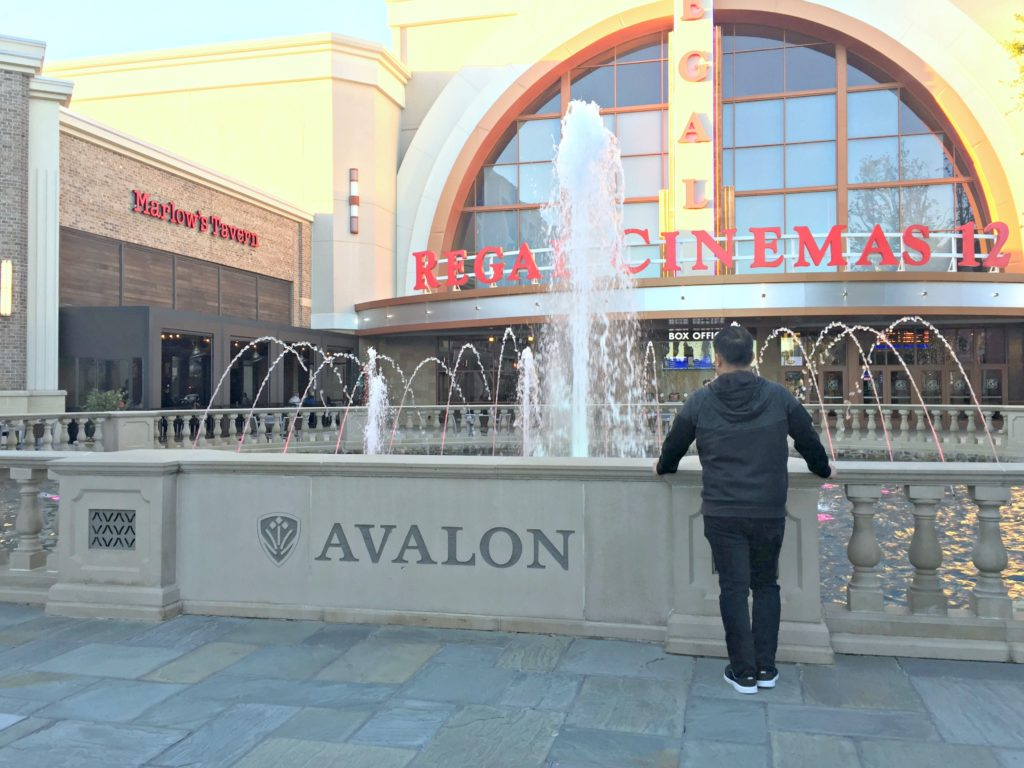 Darasak stands in front of Regal cinemas at Avalon, in Alpharetta, GA.