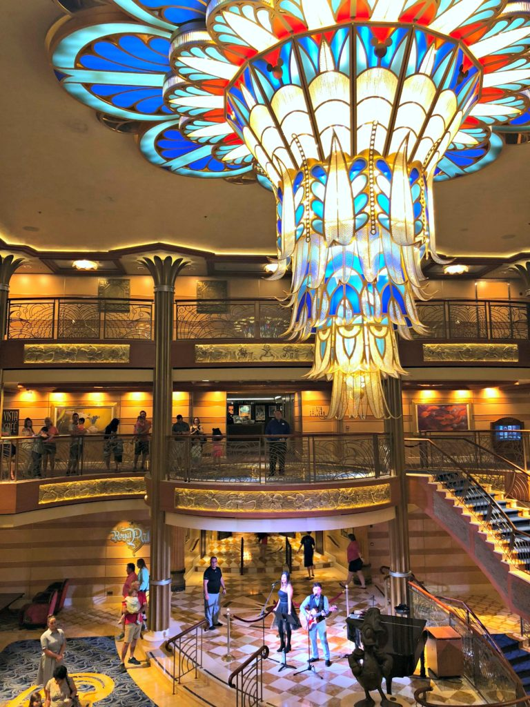 The inside of the Disney Dream with jazz singers on the stage.