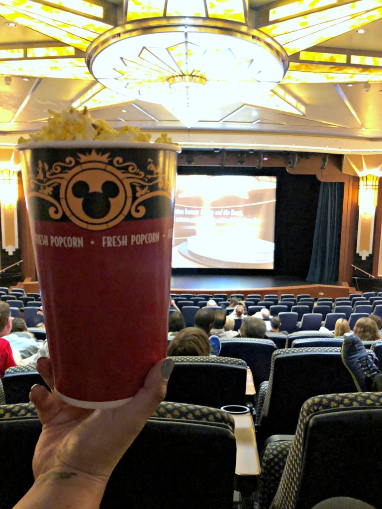 A cup of popcorn in the Disney Dream theatre.