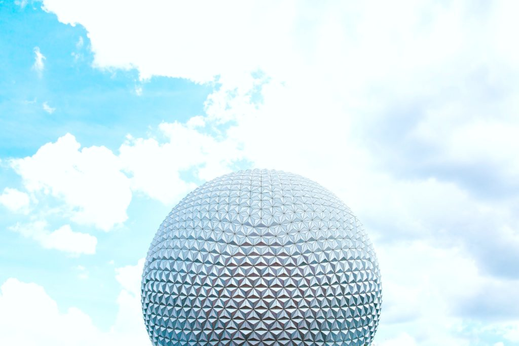 The Spaceship Earth geosphere is pictured against a blue sky.