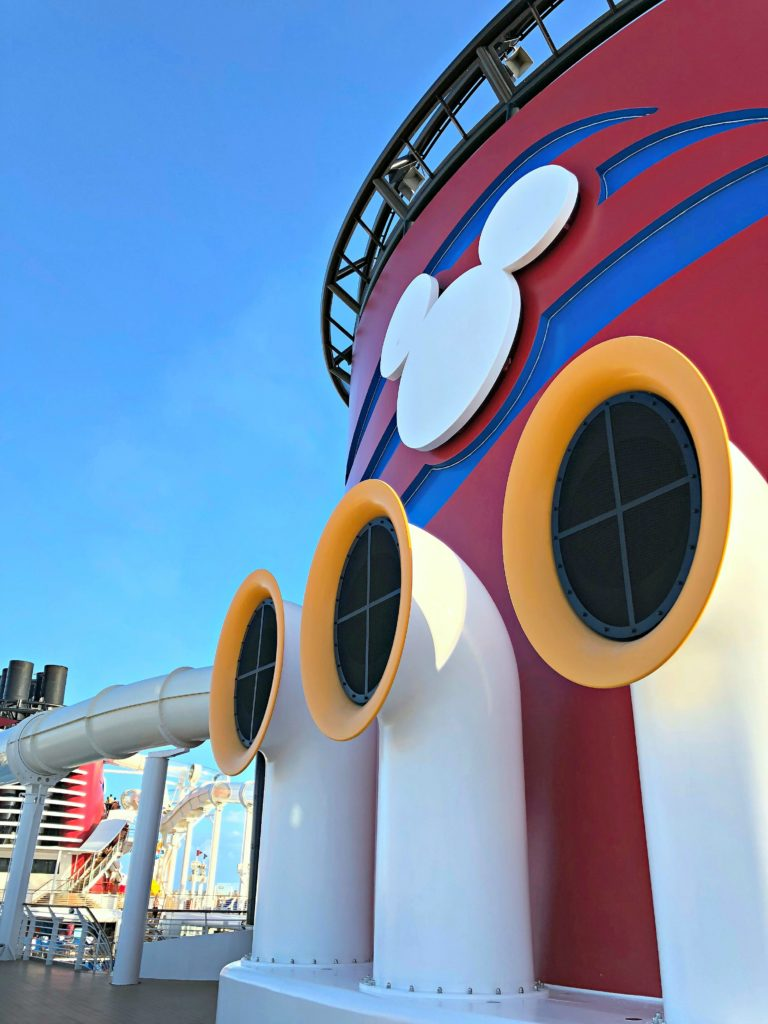 The smokestack next to the Aquaduck slide that wraps around the whole ship.