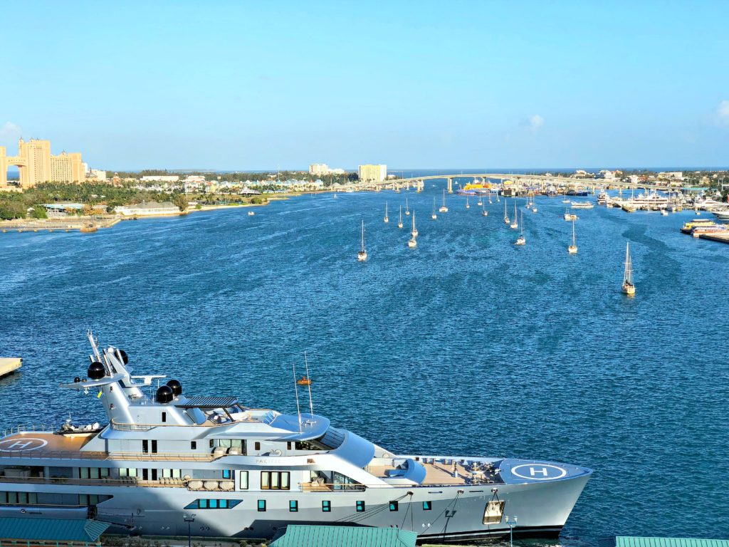 The port of Nassau is lined with sailboats and private yacht.