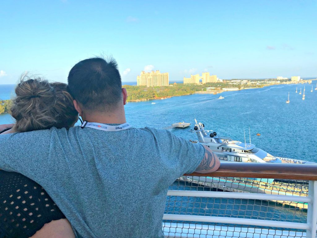 A couple hold each other while overlooking the port of Nassau.