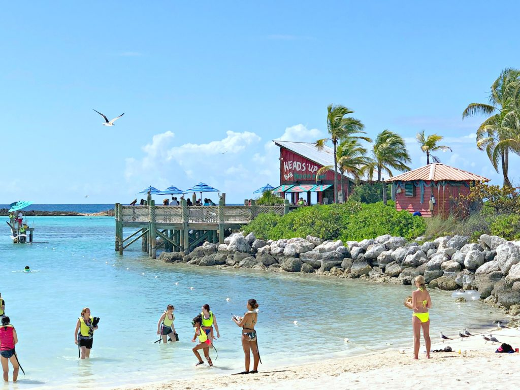 Castaway Cay family beach with snorkelers.