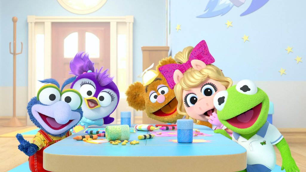 The characters of the NEW Muppet Babies sit around a table.