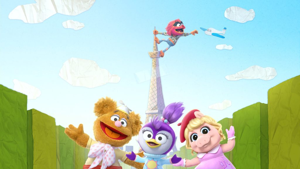 The Muppet Babies gang stand in front of a paper Eiffel Tower.