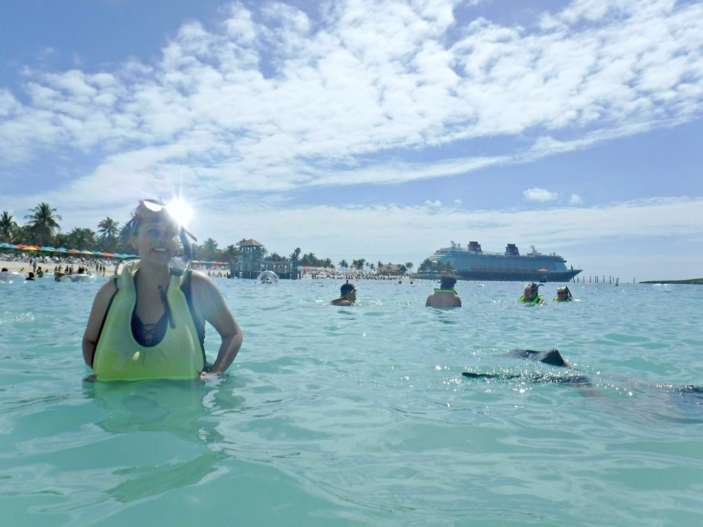 A woman snorkles at Disney's Castaway Cay, one of the many excursions you can do at Castaway Cay for adults.