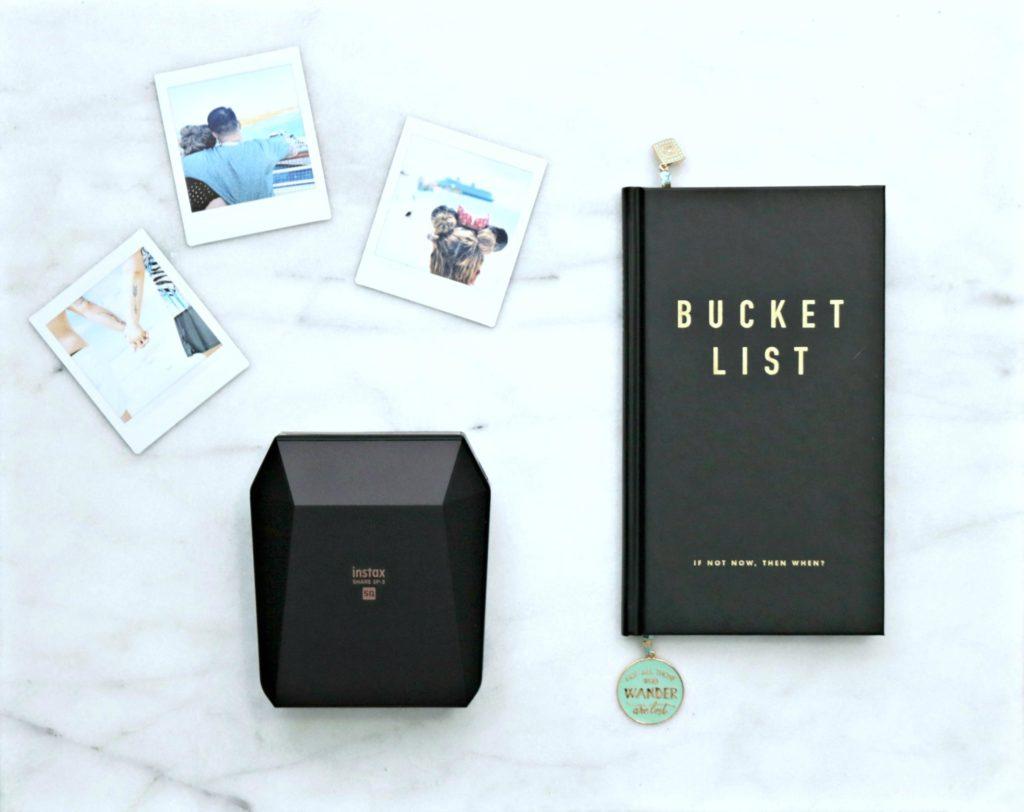 A bucket list journal, Instax printer and pictures are shown.