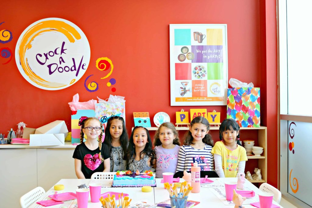 A group of girls at birthday party at Crock A Doodle.