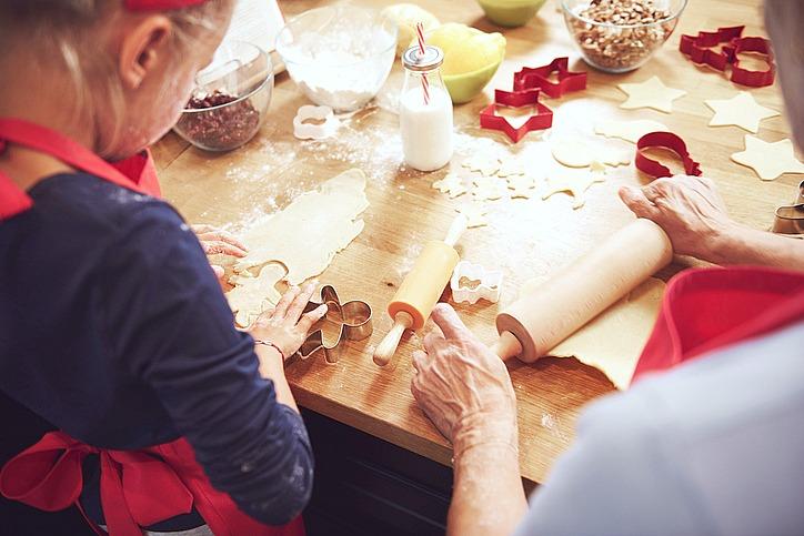 Grandma and granddaughter preparing cookies