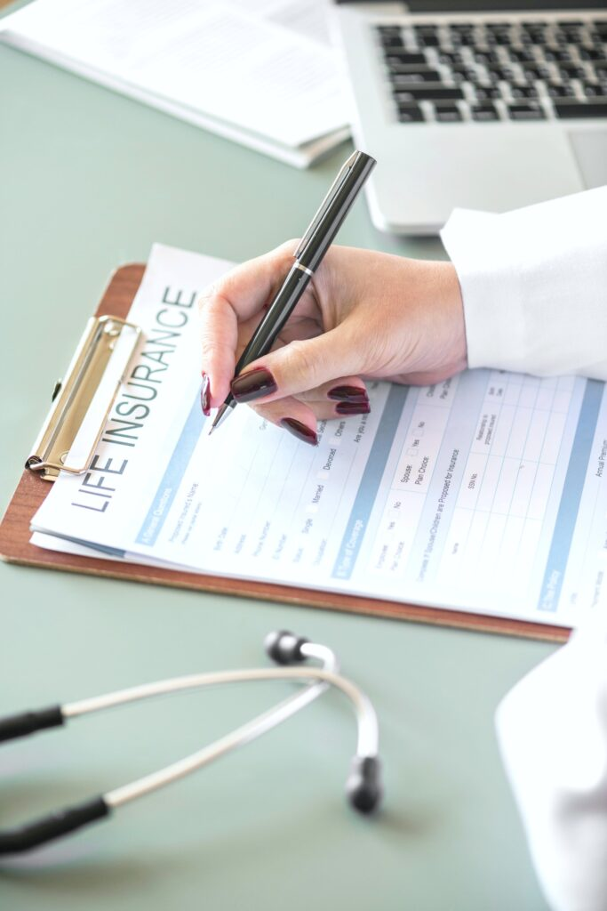 A doctor fills out a life insurance form.