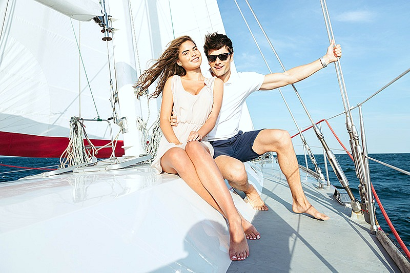 A couple relax on a yacht.