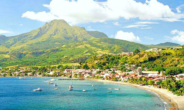 The beautiful island of Martinique has turquoise waters and large, green hills.
