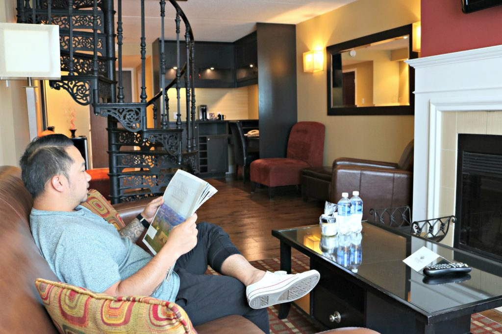 A man sits in the living room of the Executive Suite at Hockley Valley Resort.
