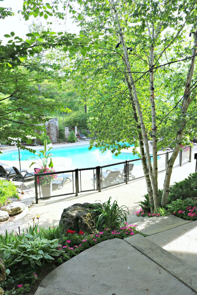 The pool and patio is shown at Hockley Valley Resort.