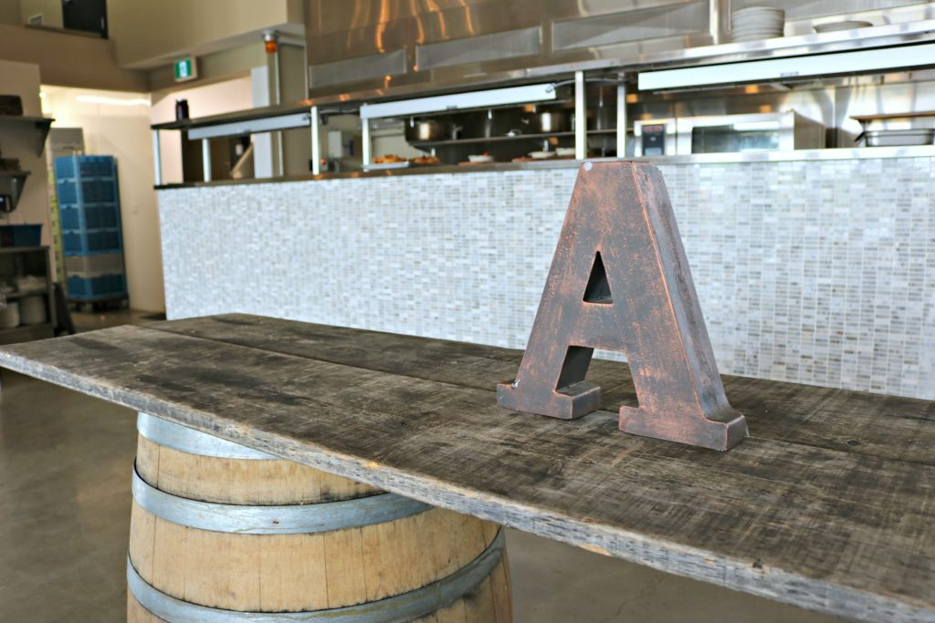 An A is shown on a rustic table in one of the halls available for rent.